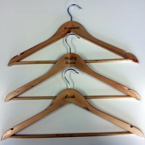 Engraved wooden wedding coat hangers